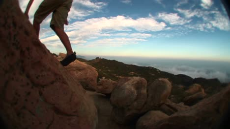 Fisheye-Of-A-Young-Hiker-Hopping-From-Boulder-To-Boulder-In-The-Santa-Barbara-Mountains