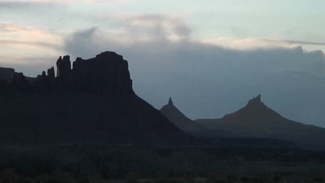 Long-Shot-Of-The-Peak-Of-A-Silhouetted-North-Sixshooter-In-Canyonlands-National-Park-Utah