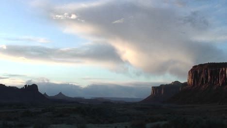 Mediumshot-Of-A-Butte-Being-Illuminated-By-Light-Of-The-Setting-Sun-Near-Moab-Utah