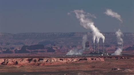 Mediumshot-Of-A-Factory-In-The-Arizona-Desert-Disgorging-Pollution