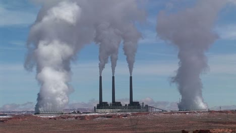 Mediumshot-Of-A-Factory-In-The-Arizona-Desert-Belching-Polluting-Fumes-Into-The-Air