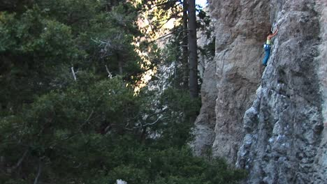 Mediumshot-Of-A-Climber-Making-Her-Way-Up-A-Granite-Cliff-Face