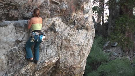 Mediumshot-Of-A-Rockclimber-Making-Her-Way-Up-A-Granite-Cliff-Face