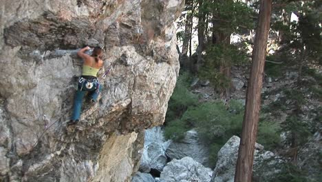 Panup-Of-A-Rock-Climber-Making-Her-Way-Up-A-Perpendicular-Rock-Cliff-Face