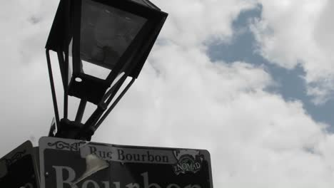 Time-Lapse-Shot-Of-Bourbon-Street-Sign-In-New-Orleans-Louisiana