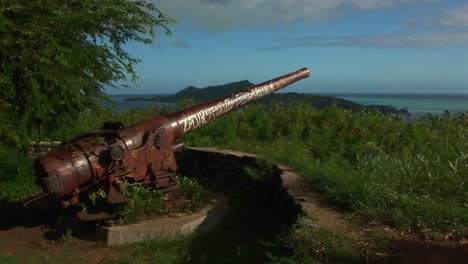 A-World-War-two-cannon-sits-rusting-on-a-mountaintop-on-a-remote-Polynesian-island