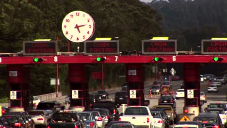 Timelapse-of-traffic-moving-through-a-tollbooth