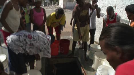 People-get-water-from-a-well-following-a-massive-earthquake-in-Haiti