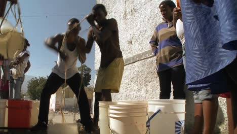 People-get-water-from-a-well-following-a-massive-earthquake-in-Haiti-1