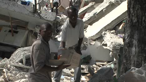 People-remove-bricks-from-a-collapsed-building-during-the-Haiti-earthquake