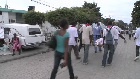A-body-is-transported-on-the-street-with-a-stretcher-during-the-Haiti-earthquake