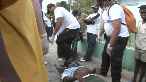 A-victim-is-moved-from-a-stretcher-during-the-earthquake-in-haiti