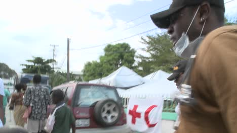 A-victim-is-moved-from-a-stretcher-during-the-earthquake-in-haiti-1