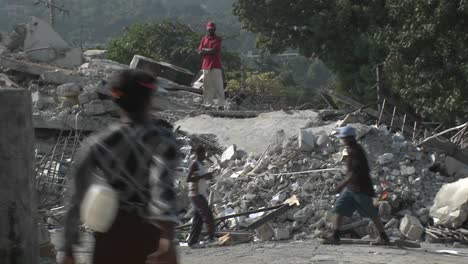 People-sift-through-the-rubble-following-the-Haiti-earthquake