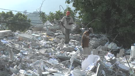 Workers-search-among-piles-of-rubble-after-the-Haiti-earthquake