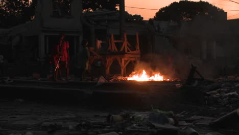 People-walk-around-an-open-fire-burning-on-the-streets-of-haiti
