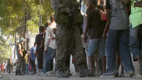 Long-lines-of-refugees-wait-on-the-streets-of-Haiti-following-their-devastating-earthquake-2