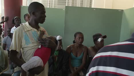 Haitians-wait-in-a-refugee-center-for-news-of-victims-of-the-Haiti-earthquake