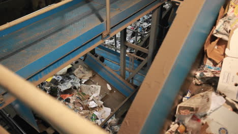 Recycling-materials-travel-on-conveyor-belts-in-a-recycling-center