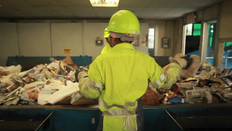Workers-sort-trash-at-a-recycling-center