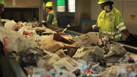 Workers-sort-trash-at-a-recycling-center-2