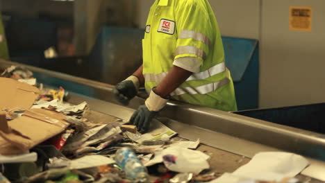 Workers-sort-trash-at-a-recycling-center-3