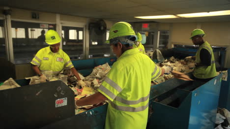 Workers-sort-trash-at-a-recycling-center-5