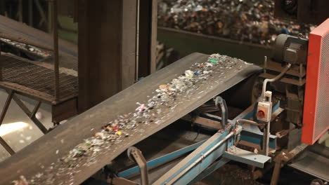 Recycled-materials-travel-on-a-conveyor-belt-at-a-recycling-center