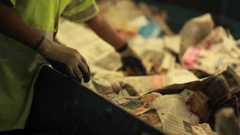 A-worker-sorts-paper-products-at-a-recycling-center