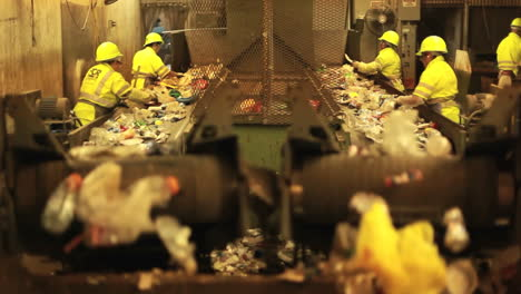 Excellent-shot-of-workers-in-a-recycling-center-sorting-trash-on-conveyor-belts-1