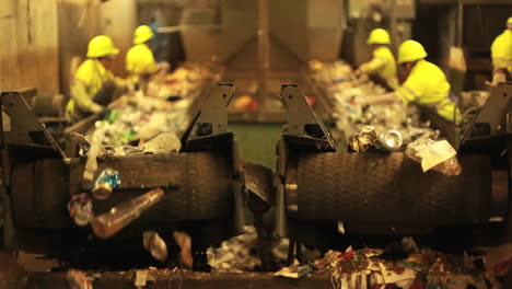 Excellent-shot-of-workers-in-a-recycling-center-sorting-trash-on-conveyor-belts-2