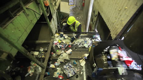 High-angle-view-of-workers-sorting-trash-at-a-recycling-center