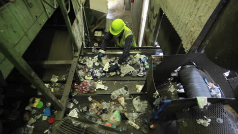High-angle-view-of-workers-sorting-trash-at-a-recycling-center-1