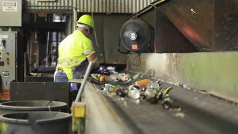 Workers-sort-trash-on-a-conveyor-belt-at-a-recycling-center