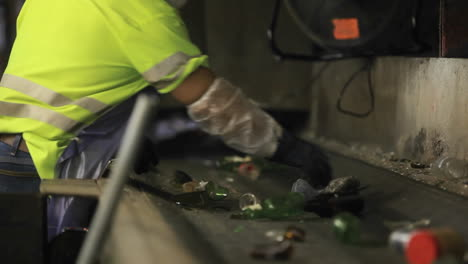 Workers-sort-trash-on-a-conveyor-belt-at-a-recycling-center-1