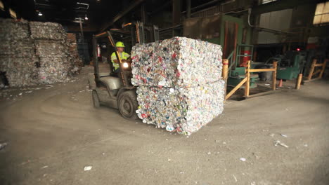 A-skip-loader-moves-aluminum-cans-at-a-recycling-center