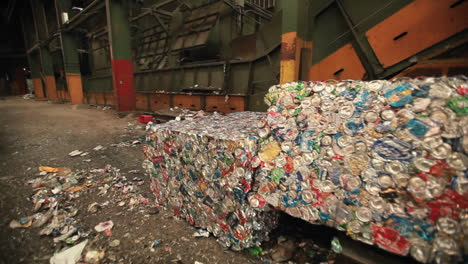 A-skip-loader-moves-aluminum-cans-at-a-recycling-center-1