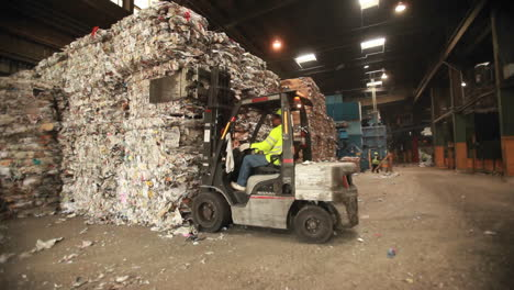 A-skip-loader-moves-aluminum-cans-at-a-recycling-center-2