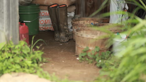 A-view-of-a-gardening-shed-with-rubber-boots-baskets-and-supplies