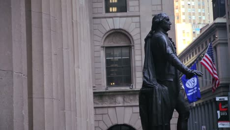 Pan-right-from-columns-to-a-statue-on-Wall-Street-in-New-York-City