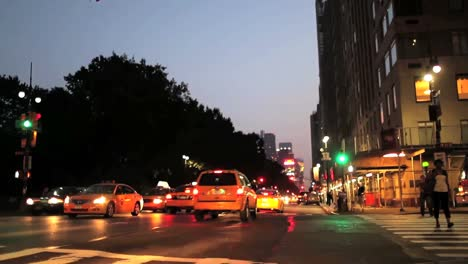Tilt-down-from-a-sign-reading-Central-Park-West-to-a-busy-intersection-in-New-York-City