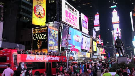Times-Square-lit-up-and-crowded-at-night