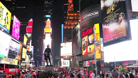 Times-Square-lit-up-and-crowded-at-night-1