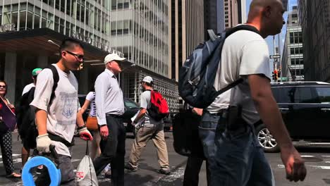 Pedestrians-pass-on-a-busy-street-in-New-York-City