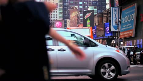 Pedestrians-pass-on-a-busy-street-in-New-York-City-1