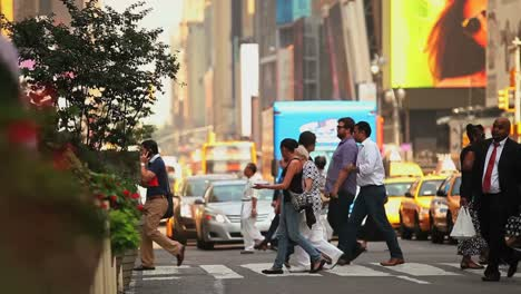 Pedestrians-pass-on-a-busy-street-in-New-York-City-2