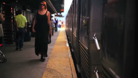 Passengers-enter-a-train-at-a-station-in-New-York-City