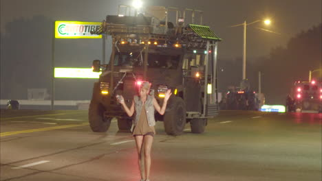 Large-military-style-vehicles-roll-through-Ferguson-Missouri-during-rioting-there