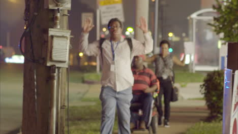 Citizens-walk-on-the-sidewalk-with-hands-raised-as-police-try-to-manage-the-rioting-in-Ferguson-Missouri