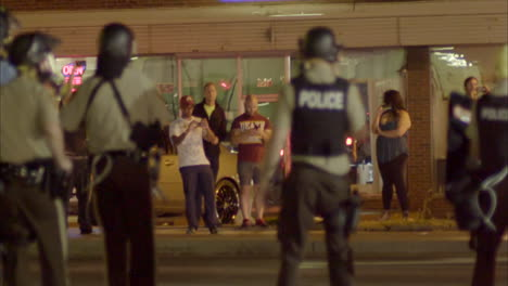 Police-with-automatic-weapons-patrol-the-streets-during-the-Ferguson-riots-1